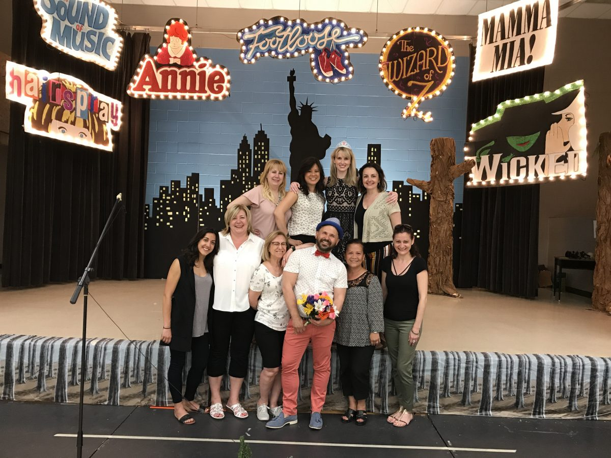 staff pose in front of the stage