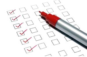 checklist with pen lying on top