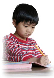 student writing in workbook
