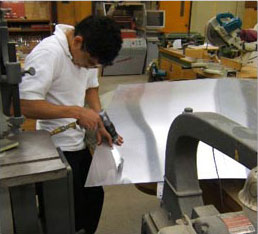 student working in metal shop