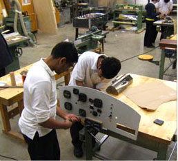 2 students working in workshop