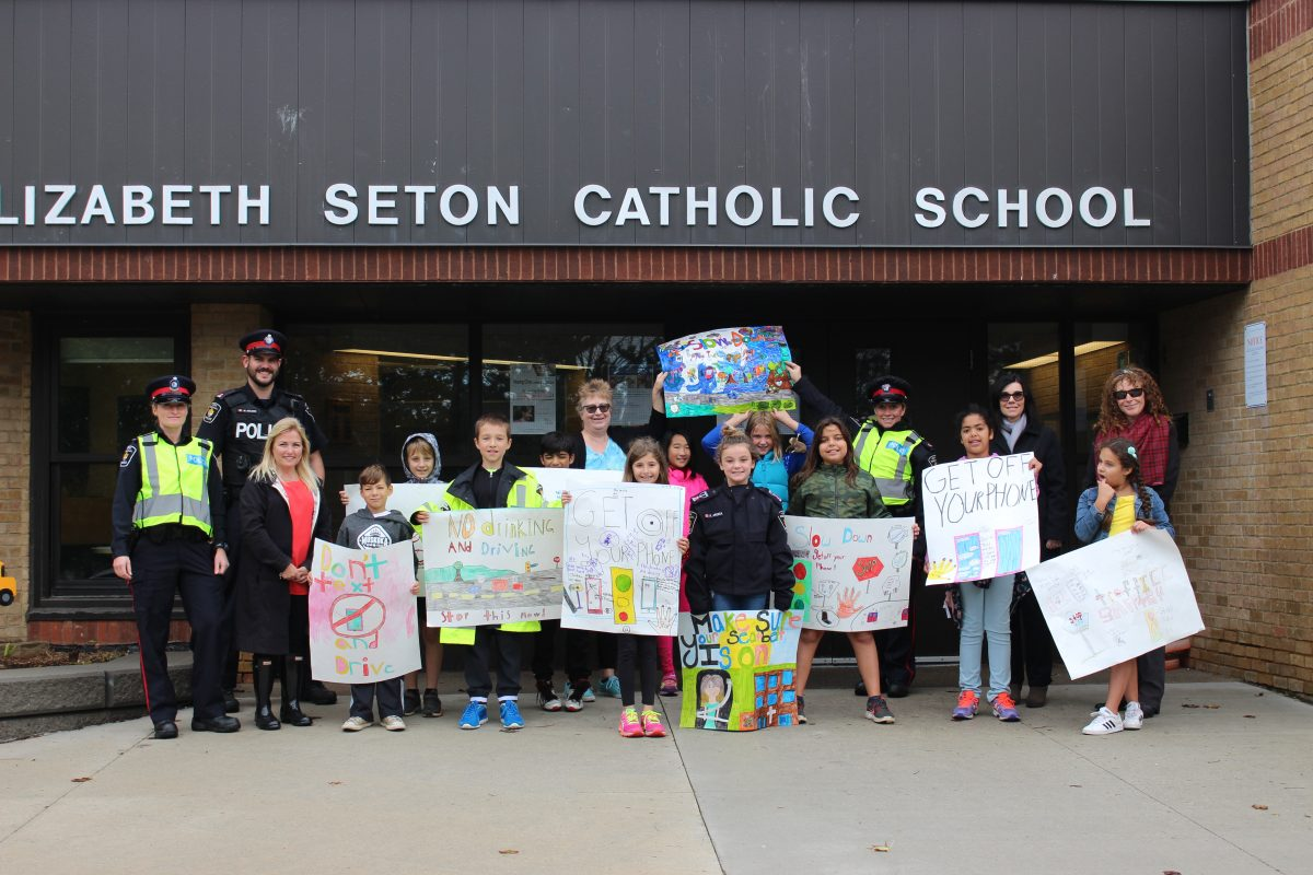 Students team up with York Regional Police to ask drivers to slow down in school zones