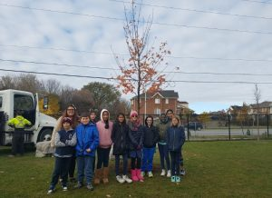"St. Brendan CES plants a red maple ""tree of hope"" for Canada 150"