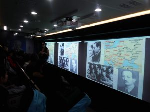 Information is displayed on a screen in the Tour for Humanity classroom