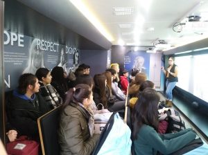 Students listening to the presentation in the Tour of Humanity classroom