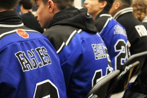 students at the assembly wearing Bressani Eagles jerseys