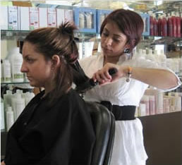 female student working in hair salon