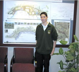 male student in front of development plans