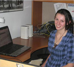female student sitting at a desk with a computer