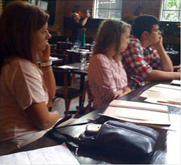 students participating in meeting inside restaurant